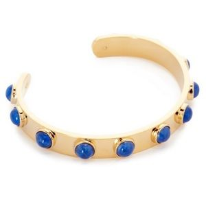 Kate Spade gold colored with blue studs bracelet.